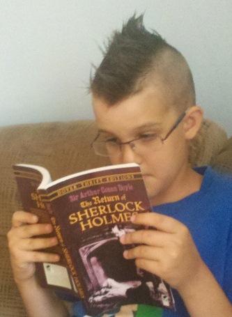 boy reading sherlock holmes book